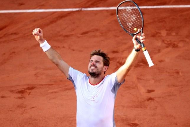 Stan Wawrinka raises his hands aloft after beating Stefanos Tsitsipas to set up a meeting with Roger Federer