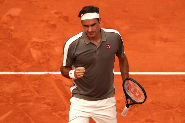 Roger Federer celebrates a point against Stan Wawrinka at the French Open