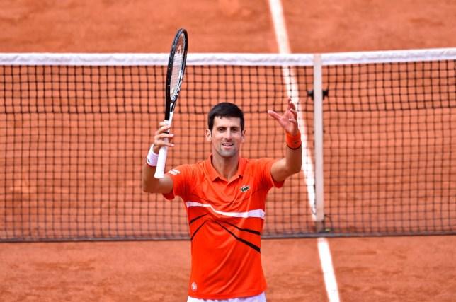 Novak Djokovic celebrates after his French Open quarter-final win