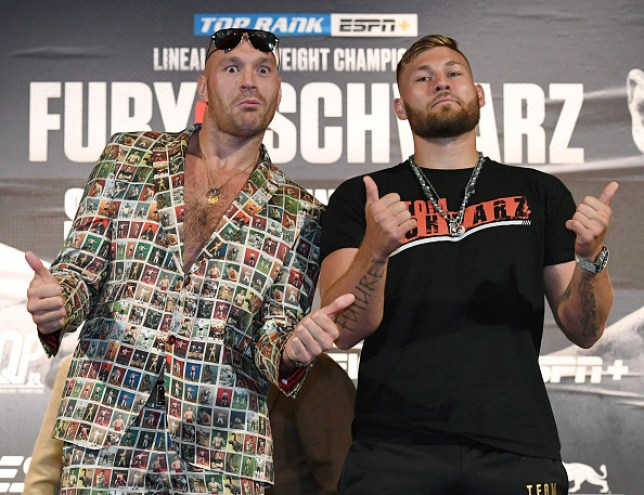 LAS VEGAS, NEVADA - JUNE 12: Boxers Tyson Fury (L) and Tom Schwarz pose during a news conference at MGM Grand Hotel & Casino on June 12, 2019 in Las Vegas, Nevada. The two will meet in a heavyweight bout on June 15 at MGM Grand Garden Arena in Las Vegas. (Photo by Ethan Miller/Getty Images)