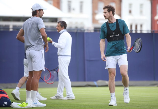 Andy Murray talks to Feliciano Lopez at Queen's