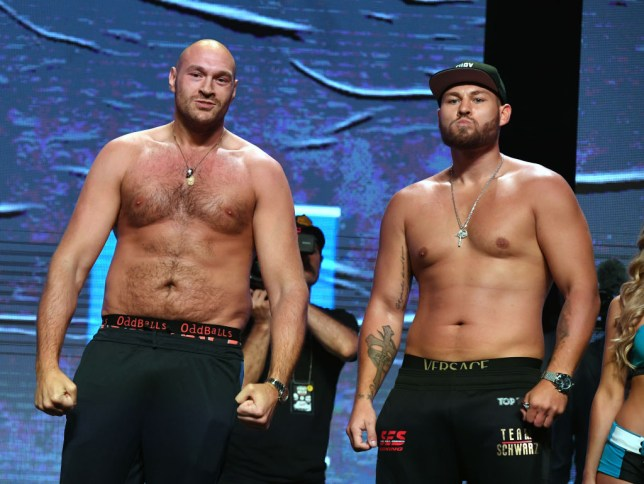 LAS VEGAS, NEVADA - JUNE 14: Boxers Tyson Fury (L) and Tom Schwarz pose during a ceremonial weigh-in at MGM Grand Garden Arena on June 14, 2019 in Las Vegas, Nevada. The two will meet in a heavyweight bout on June 15 at MGM Grand Garden Arena in Las Vegas. (Photo by Ethan Miller/Getty Images)