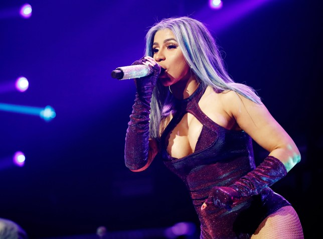 Cardi B puts indictment to back of her mind as she performs at BET Experience in glittering bodysuit