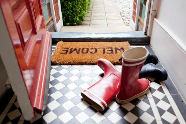 Wellies left at the door on welcome mat