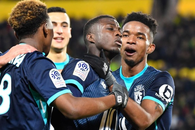 Lille's Ivorian forward Nicolas Pepe (2R) celebrates with teammates after scoring during the French L1 football match Nantes against Lille on February 11, 2018 at the La Beaujoire stadium in Nantes, western France. / AFP PHOTO / DAMIEN MEYER (Photo credit should read DAMIEN MEYER/AFP/Getty Images)