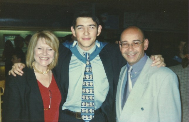 James Lubbock with both of his parents during his graduation