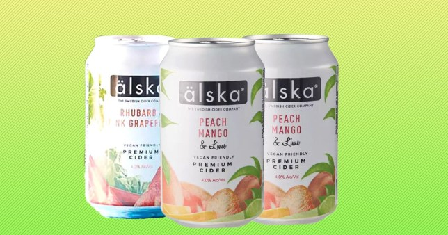 Three of the new Aldi cider cans with a green background