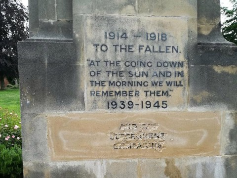 War memorial vandalised with words chiselled out