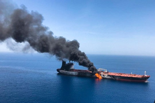 FILE - In this Thursday, June 13, 2019 file photo, an oil tanker is on fire in the sea of Oman. A series of attacks on oil tankers near the Persian Gulf has ratcheted up tensions between the U.S. and Iran -- and raised fears over the safety of one of Asia???s most vital energy trade routes, where about a fifth of the world???s oil passes through its narrowest at the Strait of Hormuz. The attacks have jolted the shipping industry, with many of operators in the region on high alert. (AP Photo/ISNA, File)