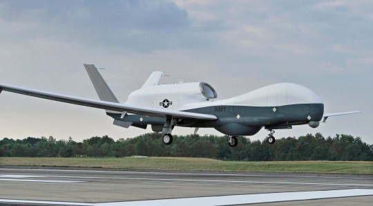 epa07659563 A handout photo made available by the US Defense Visual Information Distribution Service (DIVIDS) showing a MQ-4C Triton unmanned aircraft system preparing to land at Naval Air Station Patuxent River, Maryland, USA, 18 September 2014 after completing an approximately 11-hour flight from the Northrop Grumman manufacturing facility in Palmdale, California. Media reports on 20 June 2019 state that Iran's Islamic Revolution Guards Corps (IRGC) claim to have shot down a US spy drone over Iranian airspace, near Kuhmobarak in Iran's southern Hormozgan province. The US military has not confirmed if a drone was hit. EPA/KELLY SCHINDLER / DIVIDS / HANDO HANDOUT EDITORIAL USE ONLY/NO SALES