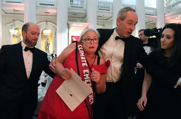 epa07661604 Climate Change protesters disrupt Chancellor of the Exchequer Philip Hammond's speech at the Mansion House during the annual Bankers and Merchants dinner in London, Britain, 20 June 2019. Hammond warned against the impact of a 'no deal' Brexit and the threat it might cause to the four nations of the UK. EPA/ANDY RAIN