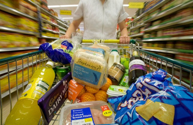A customer pushes a shopping cart through the food aisles at a Morrisons supermarket in Grays, U.K., on Tuesday, Sept. 7, 2010. William Morrison Supermarkets plc retails groceries through a chain of supermarkets and is due to announce full year earnings this week. Photographer: Chris Ratcliffe/Bloomberg via Getty Images