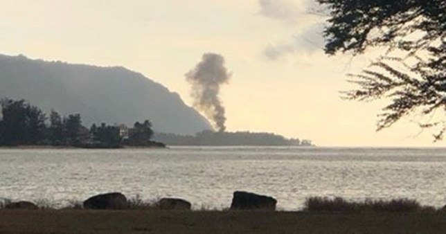 A plume of smoke rises after an airplane crash in Haleiwa, Hawaii, U.S., June 21, 2019 in this image obtained from social media. LuckyWeLive.com via REUTERS ATTENTION EDITORS - THIS IMAGE WAS PROVIDED BY A THIRD PARTY. NO RESALES. NO ARCHIVES. MANDATORY CREDIT