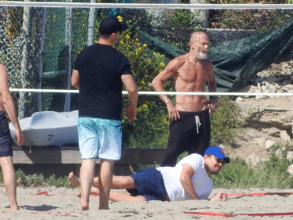 Leonardo DiCaprio playing volleyball in Malibu