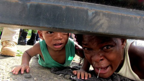 At an INM detention center in Tapachula, Fabiola, from Haiti, was clamoring under the gate for help for her sick son while they remain in a shelter enabled by the National Institute of Migration (INM) at the facilities of the Mesoamerican Fair in Tapachula, Mexico, on Tuesday, June 25, 2019.