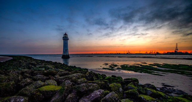 Sunset in Wirral, Merseyside with lighthouse in the background