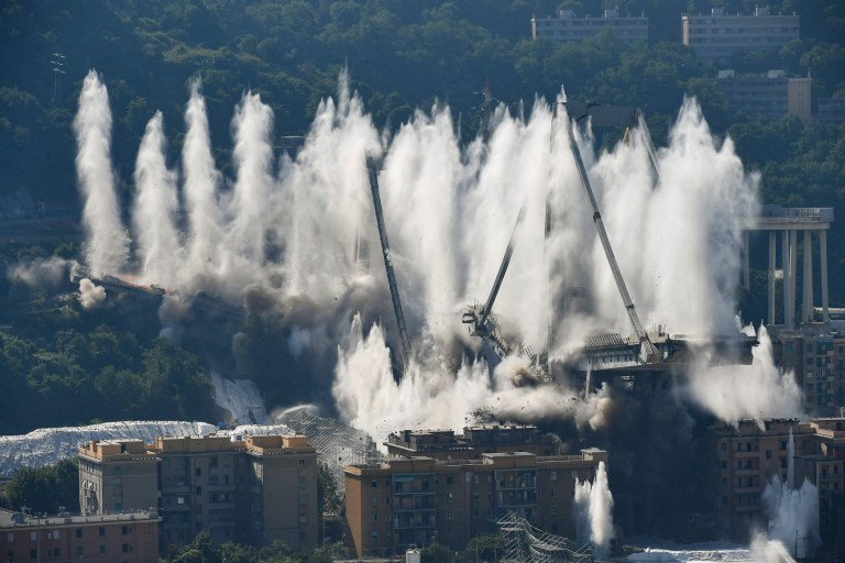 Explosive charges blow up the eastern pylons of Genoa's Morandi motorway bridge on June 28, 2019 in Genoa. - Some of the remains of Genoa's Morandi motorway bridge are set to be destroyed on June 28 almost eleven months after its partial collapse during a storm killed 43 people and injured dozens. (Photo by Vincenzo PINTO / AFP)VINCENZO PINTO/AFP/Getty Images