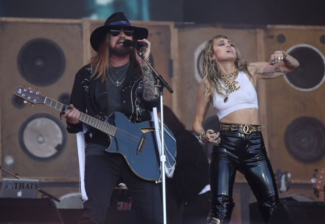 Miley Cyrus and her father Billy Ray Cyrus performing on the fifth day of the Glastonbury Festival at Worthy Farm in Somerset. PRESS ASSOCIATION Photo. Picture date: Sunday June 30, 2019. See PA story SHOWBIZ Glastonbury. Photo credit should read:Yui Mok/PA Wire