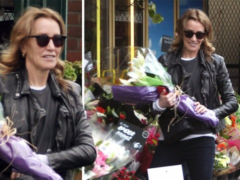 Felicity Huffman spotted buying flowers as her daughter graduates following college admissions scandal