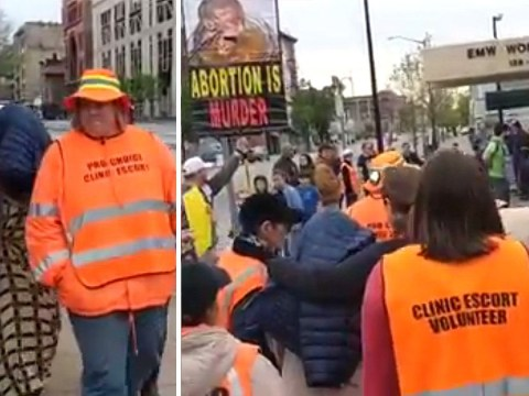 Woman escorted into abortion clinic by minders as she is harassed by pro-lifers