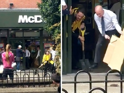 Huge rat shooed out of McDonald's by staff armed with cardboard