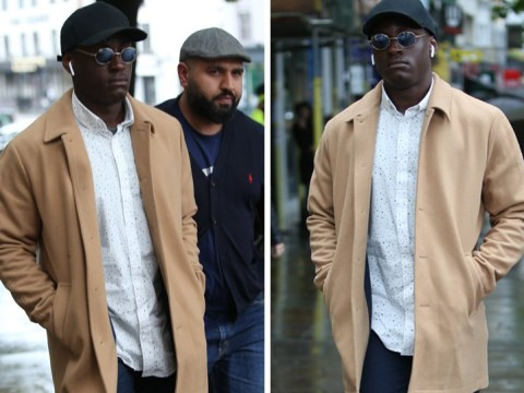 Love Island's Sherif Lanre keeps head down in London as he stays silent over controversial axe