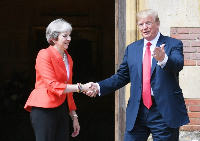 Prime Minister Theresa May and President Donald Trump shaking hands at Chequers in Aylesbury, England
