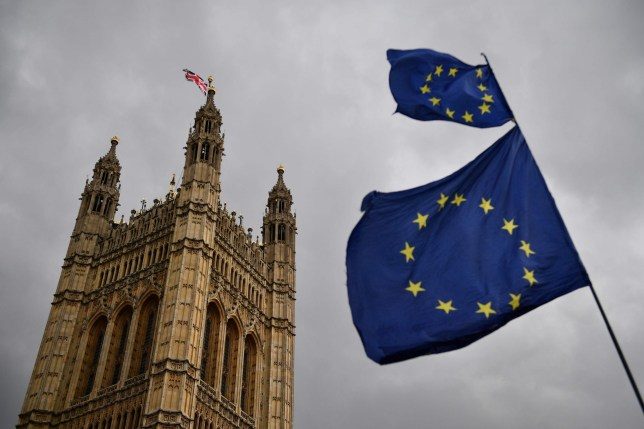 The Union flag flies atop the Houses of Parliament as EU flags held by demonstrators flutter in central London on April 4, 2019. - Britain's government redoubled its efforts Thursday to win over the main opposition party in a last-gasp bid to avoid a chaotic exit from the European Union next week. (Photo by Daniel LEAL-OLIVAS / AFP)DANIEL LEAL-OLIVAS/AFP/Getty Images
