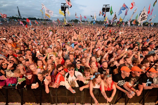 Crowd watching the Pyramid Stage at Glastonbury Festival
