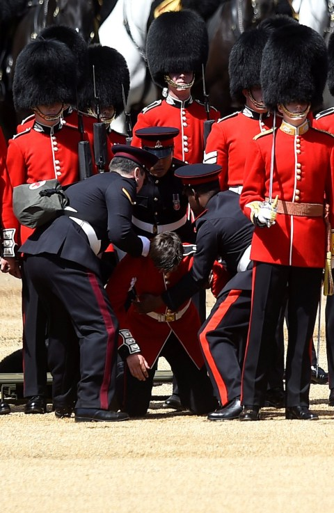 Two guardsmen faint amid sweltering heat during Trooping the