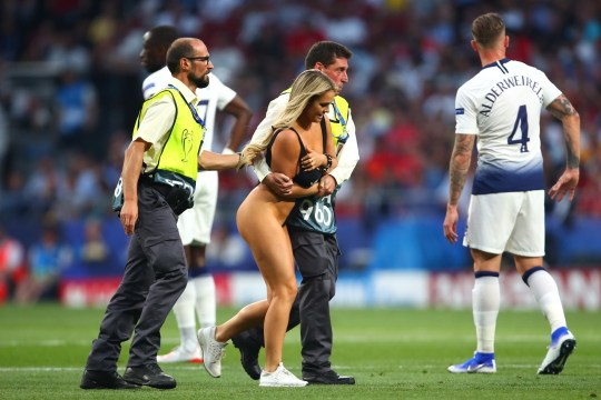 MADRID, SPAIN - JUNE 01: A pitch invader is removed by stewards during the UEFA Champions League Final between Tottenham Hotspur and Liverpool at Estadio Wanda Metropolitano on June 1, 2019 in Madrid, Spain. (Photo by Robbie Jay Barratt - AMA/Getty Images)