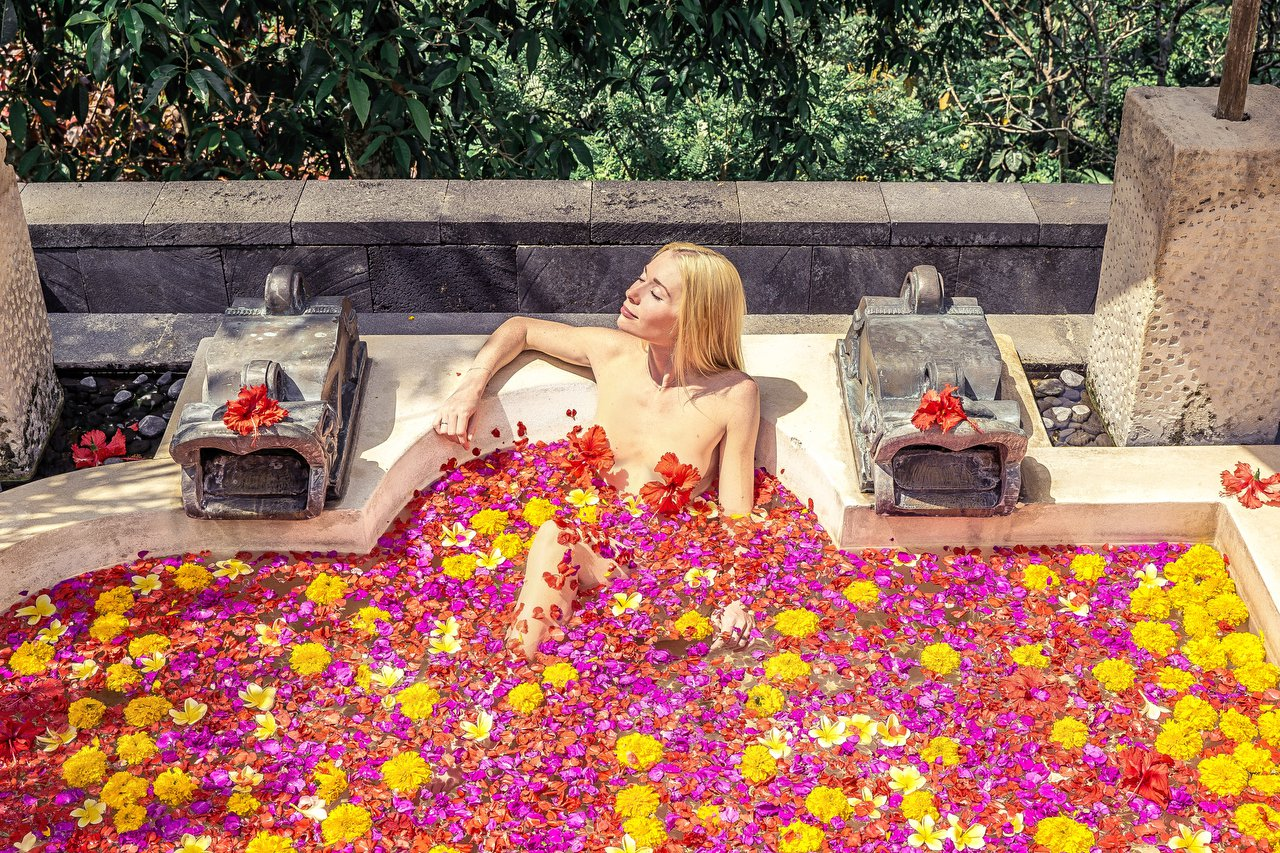 Shows: Bali, Indonesia // Pics from Jam Press (Nude traveller) Nude traveller reveals the best place in the world to get naked. Ever wondered where the best place in the world to get naked is? Well according to one Instagrammer who specialises in stripping off around the globe it's Iceland - as long as the weather is ok. Svetlana Reus, who goes by the name?@lighty_light?on social media, says she loves posing nude in as many countries as possible but the peak so far has been the land of fire and ice. She said: 'I was naked in boundless lupine fields with a breathtaking view of the mountains, then in front of the secret waterfall surrounded by incredible green colour. You can easily find a beautiful hidden spot there.' It's quite fitting that the 30-year-old should be so in love with the country - Svetlana bears more than a passing resemblance to Daenerys Targaryen of Game Of Thrones, much of which was filmed in Iceland. Fans could be forgiven for thinking they'd stumbled across an X-rated version of the mother of dragon's Insta, thanks to her poise and impressively long blonde locks. There's also plenty of drama and romance in Svetlana's feed, although mercifully not with her nephew. The Emilia Clarke look-alike has been married for five years and, on every wedding anniversary, she and her husband celebrate by getting married again, in a different country, according to that land's traditions. Svetlana's first, 'real' wedding was in Las Vegas in January 2015 but, since then, she and her man have enjoyed jetting round the world and doing it all over again. In 2016 it was a Buddhist wedding ceremony in Thailand, in 2017 it was an Arabic wedding in the desert of the UAE, 2018 was an Inca marriage in Peru and this year she celebrated a Chinese union in Hong Kong. 'Of course all the ceremonies are symbolic ones,' she explains. Her husband, who takes most of her raunchy snaps, appears in their wedding pics but is seemingly too modest to be named. 'He prefers me to call him The Master of the Universe,' jokes Svetlana. Unsurprisingly, Svetlana's Instagram combo of colourful travel snaps, true love and nudity has proved a hit and she currently has nearly 20,000 followers. 'Nature inspires me to pose naked,' she says. I'd like to reveal the beauty of unity with nature to the world and how awesome it can be. I carefully select pictures so they look artistic but not vulgar.' For the moment at least, the Instagram star is travelling and sharing her pics for the fun of it, as she doesn't get sponsored or paid. She says it's just about sharing the travel bug, which she's had for some time. Svetlana said: 'Travelling became my addiction in 2010 when I had my first trip. I tried to travel as much as possible cutting back other expenses like cinema, restaurants, new clothes etc. I met my husband in 2014 and we started travelling together, exploring the world and sharing emotions. I can't imagine my life without it now.' She has many favourite places around the world, including San Diego, Los Angeles, Vegas, the Maldives to relax, Barcelona for exploring, Peru for the food, Japan for the culture and the UK for its spirit. Svetlana, who is Russian, added: 'My heart belongs to Tanzania and South Africa. I?ll never get tired of its wild beauty. Their hospitality is the best I?ve ever seen.' The freelance IT manager currently lives in Greece 'because of the good climate' but says 'the whole world is my home.' Next on her itinerary is Hawaii where she'll no doubt forgo the hula skirt if possible. 'I feel quite comfortable in front of the camera,' says Svetlana. 'It's fun.' ENDS