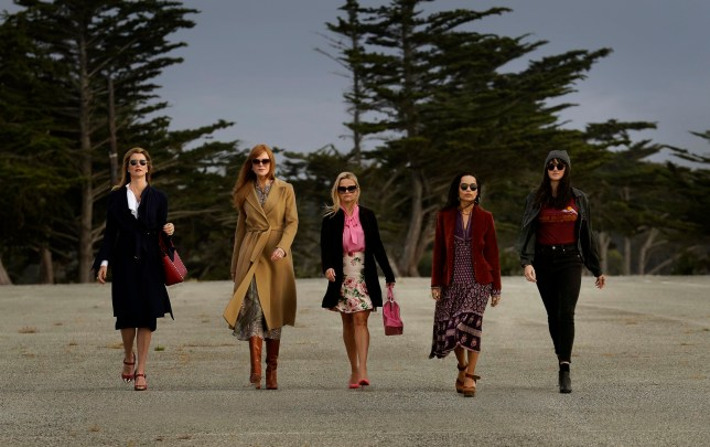 The main characters from HBO's Big Little Lies walking down a pavement with trees in the background, including Laura Dern, Nicole Kidman, Reese Witherspoon, Zoe Kravitz and Shailene Woodley