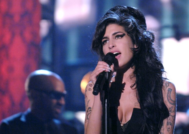 Amy Winehouse performing on stage