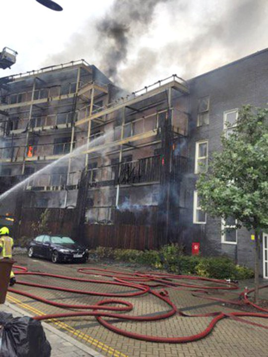 Around 100 firefighters are working to tackle the fire at the scene on De Pass Gardens in Barking.