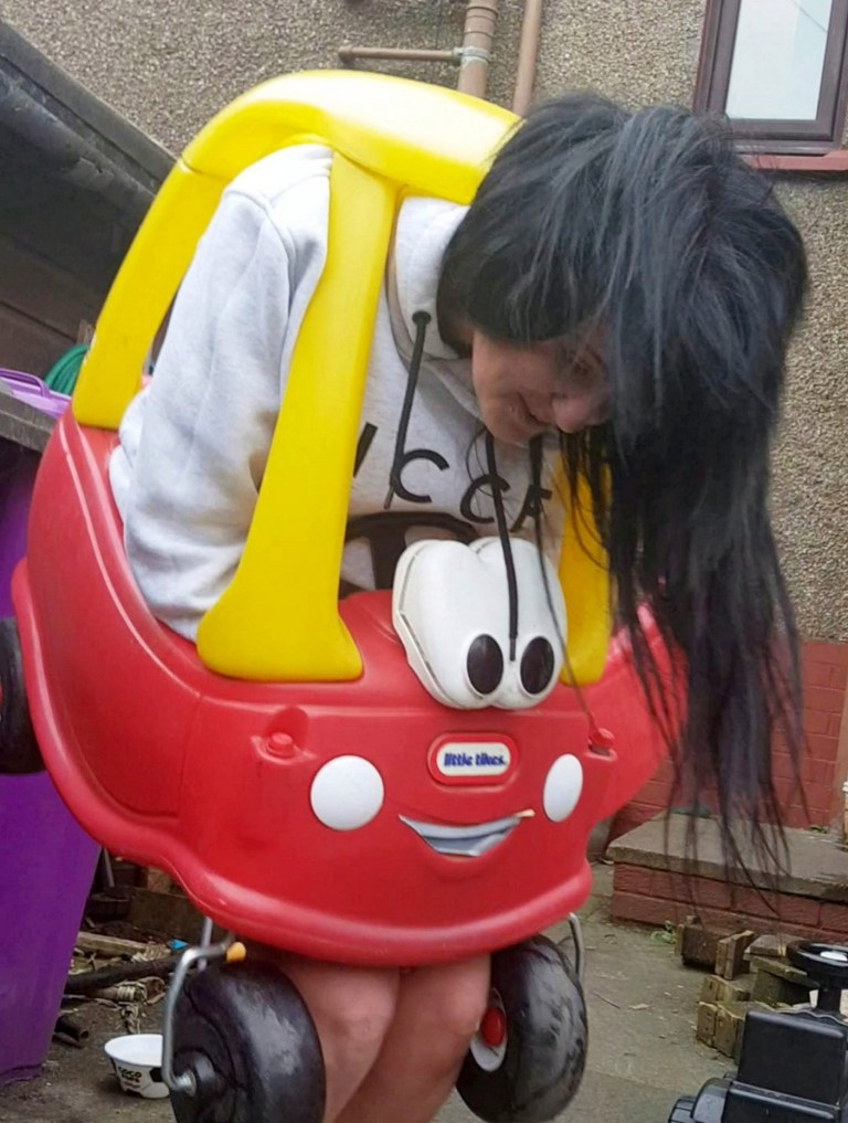 This is the hilarious moment a woman has to be cut free from a toddler's toy car using a bread knife. See SWNS story SWSYcar. Zoe Archibald, 34, managed to get herself completely stuck in the children's car for an hour after climbing into it for a joke. But as soon as she crammed herself into the tiny plastic car - she realised she was stuck and couldn't get out. Hilarious video footage shows how Zoe, from Brechin, Angus, Scotland, had to be cut free using a bread knife after the joke back-fired. Her nephew, Matthew Shepherd-Bull, filmed from the moment she got trapped to the moment she was cut free. Matthew, 26, says Zoe managed to find the funny side to the failed stunt despite being unable to wriggle out of the car herself.