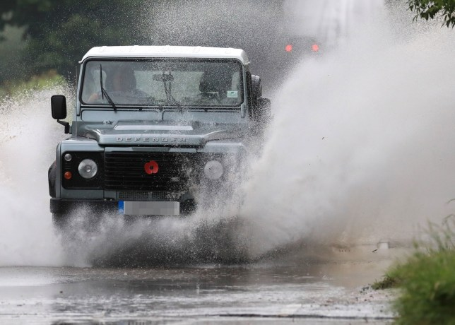 A Land Rover crashes through standing water on a road near Tenterden in Kent, following heavy rain. PRESS ASSOCIATION Photo. Picture date: Monday June 10, 2019. See PA story WEATHER Rain. Photo credit should read: Gareth Fuller/PA Wire