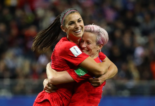Alex Morgan of the USA celebrates with teammate Megan Rapinoe after scoring her team's twelfth goal against Thailand