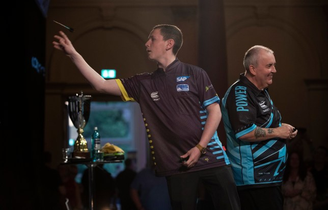 SAP DARTS SLAM PALMENGARTEN, FRANKFURT ROUND 1 LEIGHTOM BENNETT V PHIL TAYLOR LEIGHTON BENNETT WINS THIS IS WHAT HAPPENS WHEN YOU ARE 13 YEARS OLD AND YOU BEAT THE GREATEST PLAYER OF ALL TIME