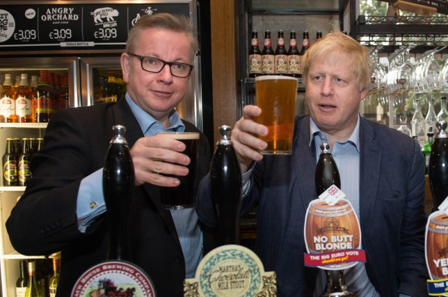 Michael Gove and Boris Johnson (right) pull pints of beer at the Old Chapel pub in Darwen in Lancashire, as part of the Vote Leave EU referendum campaign.