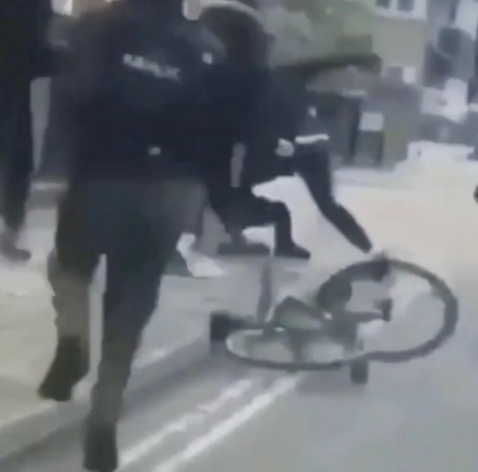 The gang catch up with their target and throw him to the ground and begin a savage assault where the man is kicked, punched and stabbed, Brent, London, Tuesday 11th June, 2019. SHOCKING footage has emerged of the brutal stabbing which left a young man seriously injured in North West London yesterday afternoon (Tuesday 11th June). The victim, believed to be in his 20s, was found near Willesden Magistrates? Court just before 3.30pm yesterday. The man had been stabbed several times in the brutal attack, which took place in broad daylight. The victim was initially thought to be fighting for his life, but his condition has since improved. The appalling attack is believed to have filmed by one of the assailants and the clip has since been shared across social media. In the distressing clip, a group of hooded thugs are seen chasing after the victim on bicycle and on foot. A cackling accomplice drives behind them in a car and films the attack. The gang eventually catch up to the young man and the man filming stops the vehicle to apparently join them. The thugs can be seen savagely kicking, punching and stabbing the victim who lies on the ground. ... SEE COPY AND VID ? PIC BY NEWS DOG MEDIA ... 0121 517 0019 ... pictures@newsdogmedia.co.uk