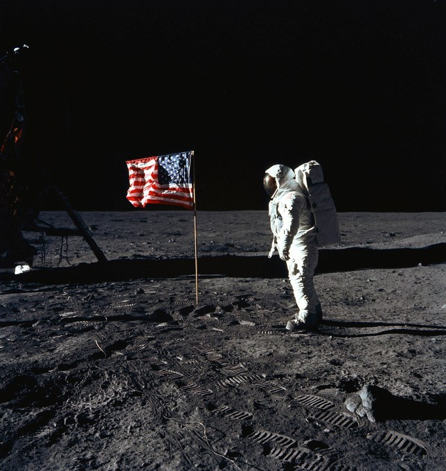 """This July 20, 1969, photo obtained from NASA and taken by Neil Armstrong, shows astronaut Buzz Aldrin on the Moon's Sea of Tranquility. - When the Saturn V rocket built by Wernher von Braun launched with the Apollo 11 capsule at its summit on July 16 1969, one million people flocked to watch the spectacle on the beaches of Florida near Cape Canaveral. But many had doubts that they'd succeed in landing this time. (Photo by Neil ARMSTRONG / NASA / AFP) / **RESTRICTED TO EDITORIAL USE - MANDATORY CREDIT """"AFP PHOTO / NASA"""" - NO MARKETING - NO ADVERTISING CAMPAIGNS - DISTRIBUTED AS A SERVICE TO CLIENTS **TO GO WITH AFP STORY by Ivan Couronne, """"To the Moon and back: mankind's giant leap 50 years on""""NEIL ARMSTRONG/AFP/Getty Images"""