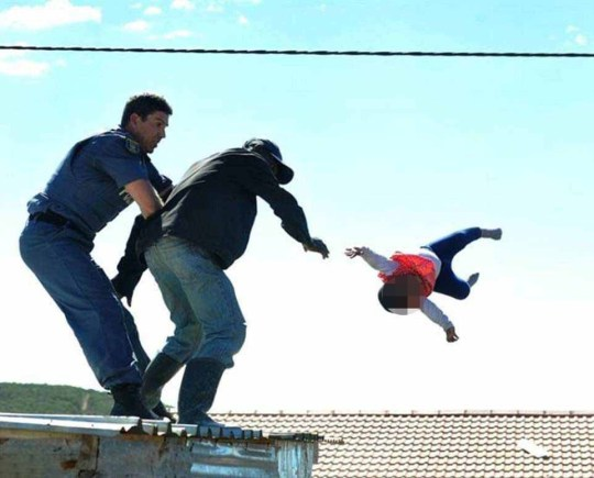 The moment a father throws his daughter off his ROOF in stand-off with South African police before cops catch her and save her lifehttps://www.dailymail.co.uk/news/article-5611277/Father-throws-six-month-old-daughter-roof-shack.html