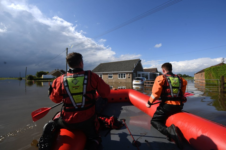 Rescue workers in Wainfleet All Saints, in Lincolnshire, where streets and properties are flooded after the town had more than two months of rain in just two days. The Royal Air Force has been drafted in after the River Steeping breached its banks. PRESS ASSOCIATION Photo. Picture date: Friday June 14, 2019. See PA story WEATHER Rain. Photo credit should read: Joe Giddens/PA Wire
