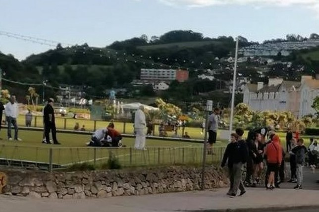 Picture - The teenagers pinned down after the brawl erupted on the bowling green (Image: Spotted Teignmouth) A Saturday evening bowls match turned into a brawl after a group of teenagers allegedly attacked pensioners, leaving one injured in hospital. The incident unfolded in Teignmouth as The Den hosted Lyme Regis in a regular match at the seaside town last Saturday. But the afternoon turned sour after a group of youths invaded the bowling green armed with stones, and decided to attack an elderly man, leaving him with cuts to his face. The ugly scenes lasted for around half an hour before an off-duty police officer, who was jogging past, intervened to help out taking one of the culprits down.
