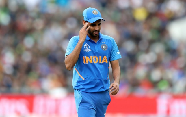 India's Bhuvneshwar Kumar leaves the field of play after picking up an injury during the ICC Cricket World Cup group stage match at Emirates Old Trafford, Manchester. PRESS ASSOCIATION Photo. Picture date: Sunday June 16, 2019. See PA story CRICKET India. Photo credit should read: Martin Rickett/PA Wire. RESTRICTIONS: Editorial use only. No commercial use. Still image use only.