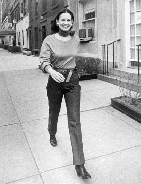 FILE- In this undated file photo heiress and designer Gloria Vanderbilt walks down a New York street. Vanderbilt died on Monday, June 17, 2019, at 95, according to her son, CNN anchor Anderson Cooper. (New York Post via AP, File)
