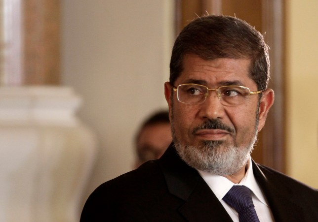 FILE - In this July 13, 2012 photo, Egyptian President Mohammed Morsi holds a news conference with Tunisian President Moncef Marzouki, at the Presidential palace in Cairo, Egypt. On Monday, June 17, 2019, Egypt's state TV said that the country's ousted President Mohammed Morsi has collapsed during a court session and died. (AP Photo/Maya Alleruzzo, File)