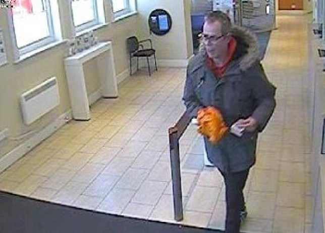 BNPS.co.uk (01202 558833) Pic: DorsetPolice/BNPS CCTV stills from the bank showing Laurence Vonderdell. Police nearly let slip a robber who held up a bank with a banana by refusing to arrest him when he confessed to the 'laughable' crime, a court heard. Laurence Vonderdell was said to have tried to hand himself in to two officers he came across minutes after pretending the yellow fruit in a carrier bag was a gun in the bank raid. But the duo didn't believe him and sent him on his way, the hearing heard. Vonderdell, 50, walked 2.5 miles with ?1,200 in ?20 notes from the robbery until he reached Bournemouth police station in Dorset.