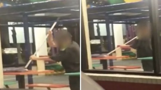 The Burger King worker was filmed by Katie Duran scrubbing a kids' play area table top with a mop moments after using the same cleaning tool on a dirty floor